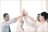 33301281-success-and-winning-concept--happy-business-team-giving-high-five-in-office-1.jpg